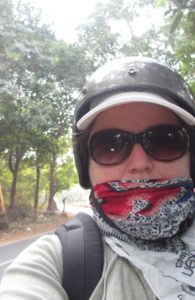 Scooter rider in helmet and sunglasses