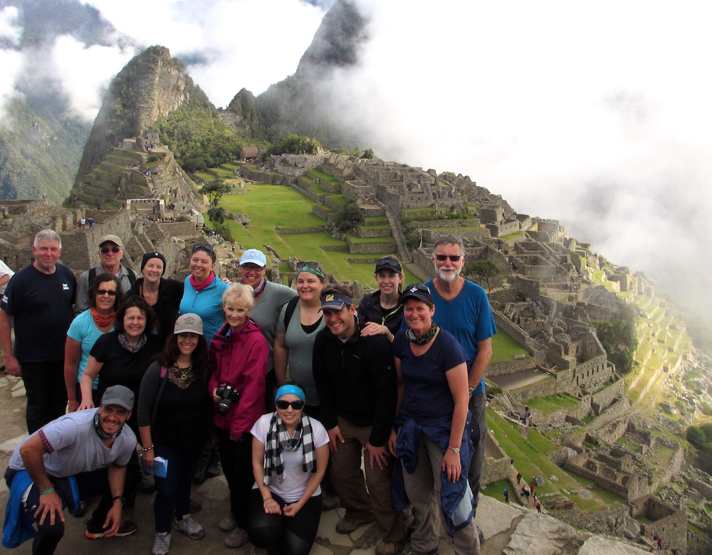 Tour group photo with Machu Picchu in the background.