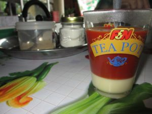 Glass of tea with condensed milk at the bottom