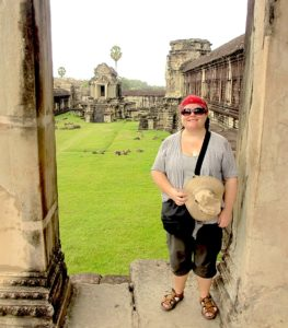"""The writer posing near the """"library"""" in Angkor Wat complex"""