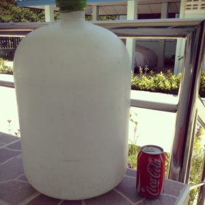 20-litre bottle of water next to a can of Coke.